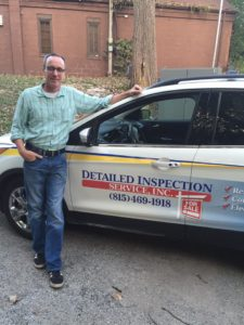 Home inspector Rob Gisch standing next to his company vehicle