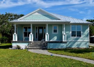 Seafoam green house with porch