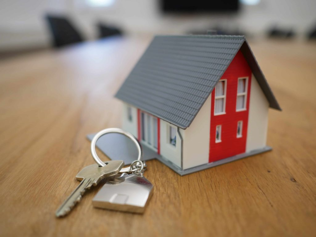 Model house next to key to promote home inspections