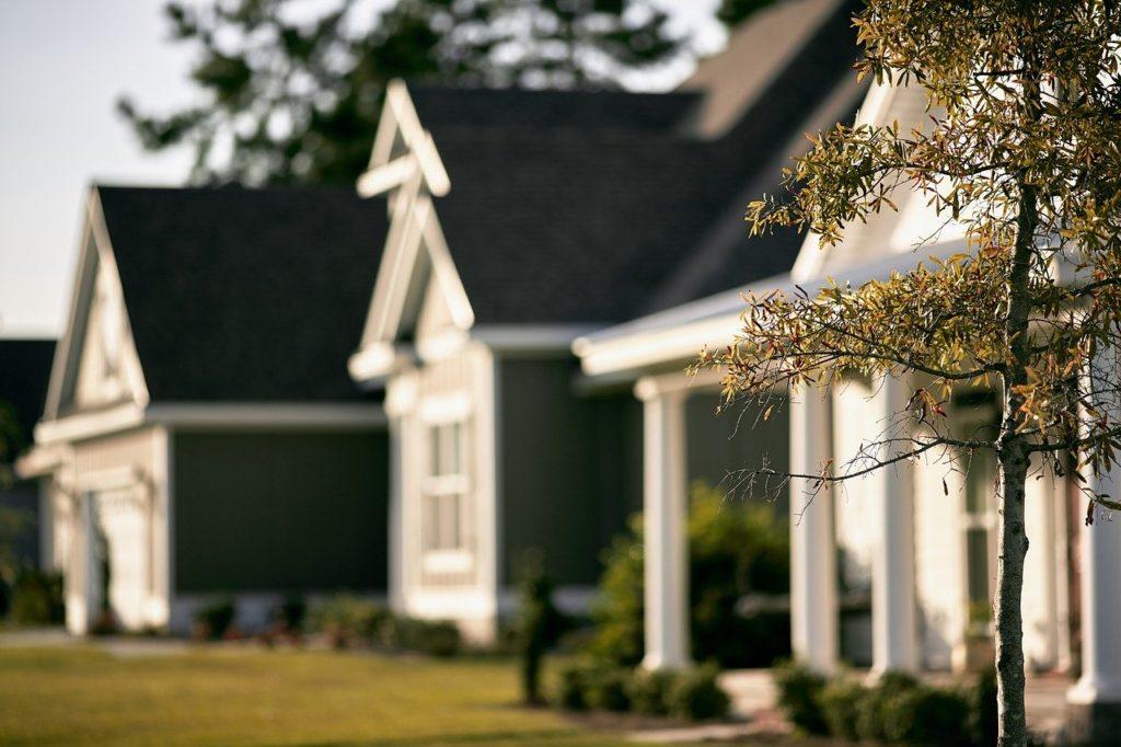 homes requiring professional inspections lining a neighborhood street