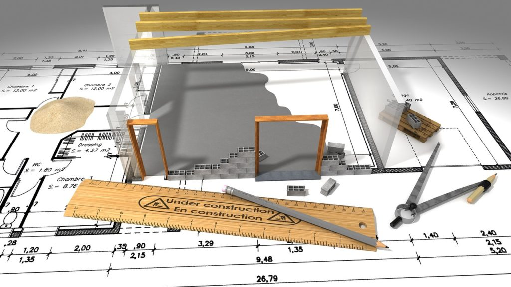 blueprint and model of building construction